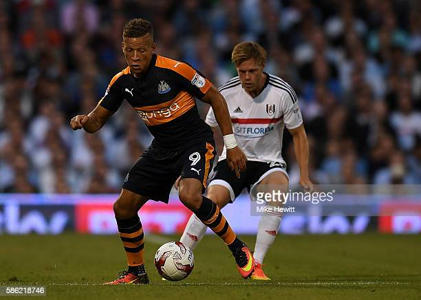Dwight Gayle of Newcastle holds off pressure from Lasse Vigen Christensen of Fulham during the Sky Bet Championship match between Fulham and...