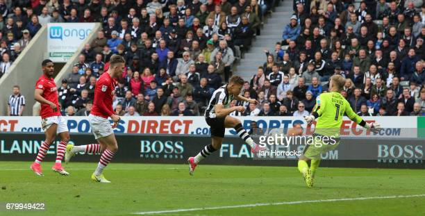 Dwight Gayle of Newcastle scores the final goal during the Sky Bet Championship match between Newcastle United and Barnsley at St James' Park on May...