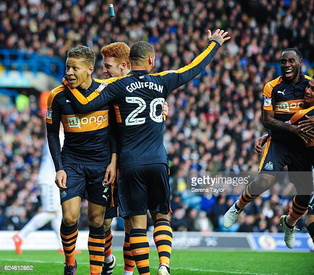 Dwight Gayle of Newcastle smiles with teammates Jack Colback and Yoan Gouffran after an inhaler is thrown at him after he scored Newcastle's second...