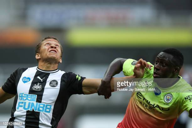 Dwight Gayle of Newcastle United and Benjamin Mendy of Manchester City during the FA Cup Quarter Final match between Newcastle United and Manchester...