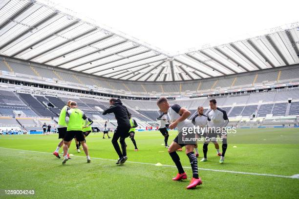 Dwight Gayle of Newcastle United and teammates warm up prior to the Premier League match between Newcastle United and Liverpool FC at St James Park...
