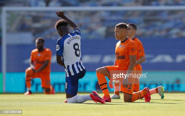 Dwight Gayle of Newcastle United and Yves Bissouma of Brighton and Hove Albion take a knee in support of the Black Lives Matter movement during the...