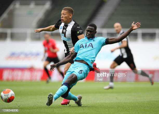 Dwight Gayle of Newcastle United battles for possession with Davinson Sanchez of Tottenham Hotspur during the Premier League match between Newcastle...