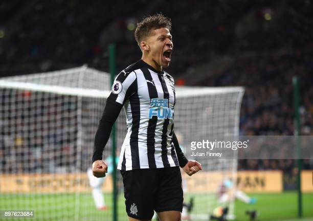 Dwight Gayle of Newcastle United celebrates after Christian Atsu scores his sides third goal during the Premier League match between West Ham United...