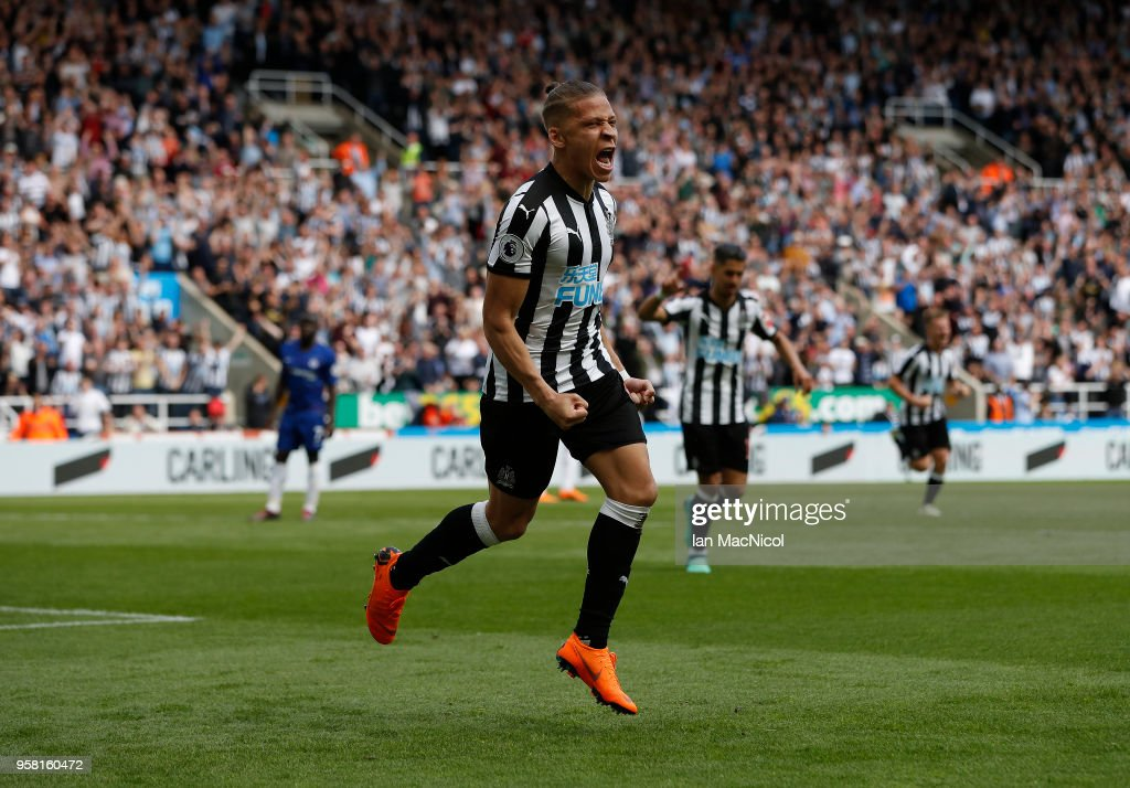 Dwight Gayle of Newcastle United celebrates after he score the opening goal during the Premier League match between Newcastle United and Chelsea at St. James Park on May 13, 2018 in Newcastle upon Tyne, England.