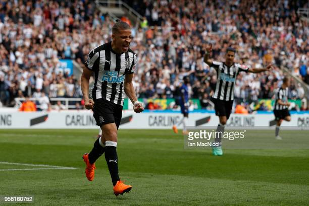 Dwight Gayle of Newcastle United celebrates after he score the opening goal during the Premier League match between Newcastle United and Chelsea at...