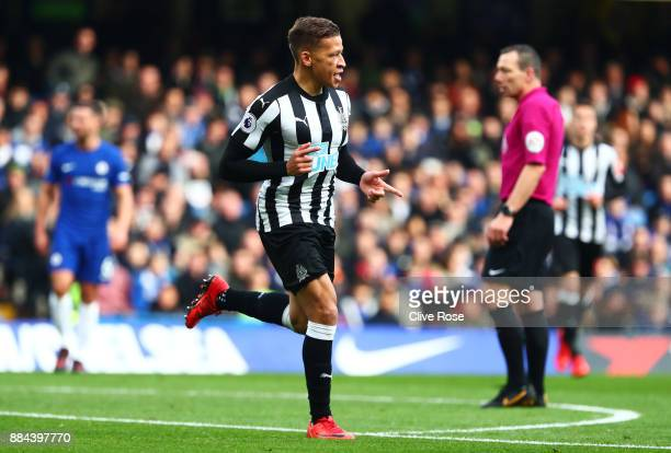 Dwight Gayle of Newcastle United celebrates after scoring his sides first goal during the Premier League match between Chelsea and Newcastle United...