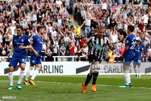 Dwight Gayle of Newcastle United celebrates after scoring his sides first goal during the Premier League match between Newcastle United and Chelsea...
