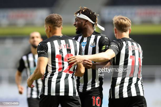 Dwight Gayle of Newcastle United celebrates after scoring his team's first goal during the Premier League match between Newcastle United and...