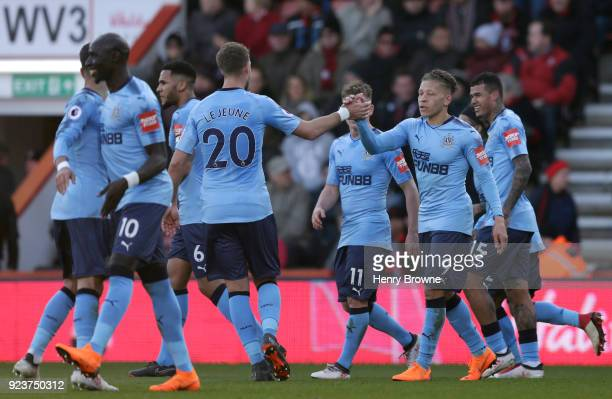Dwight Gayle of Newcastle United celebrates scoring his side's second goal with Florian Lejeune and team mates during the Premier League match...