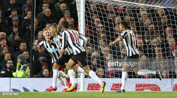 Dwight Gayle of Newcastle United celebrates scoring their first goal during the Premier League match between Manchester United and Newcastle United...