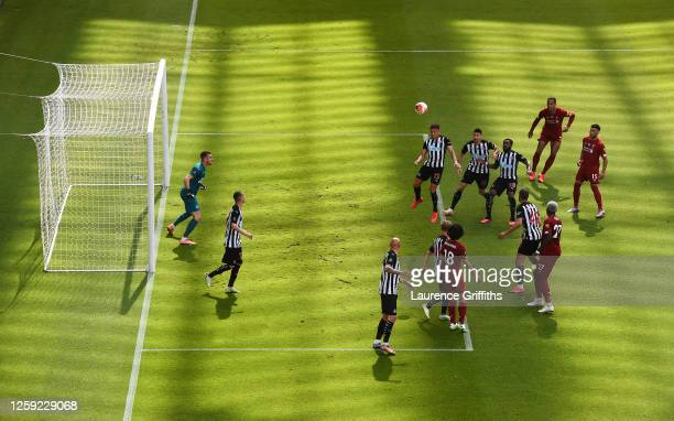 Dwight Gayle of Newcastle United clears the ball from a corner the Premier League match between Newcastle United and Liverpool FC at St James Park on...