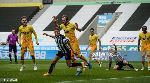 Dwight Gayle of Newcastle United FC controls the ball as Harry Kane of Tottenham Hotspur defends during the Premier League match between Newcastle...
