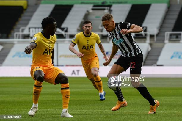 Dwight Gayle of Newcastle United FC controls the ball during the Premier League match between Newcastle United and Tottenham Hotspur at St. James...