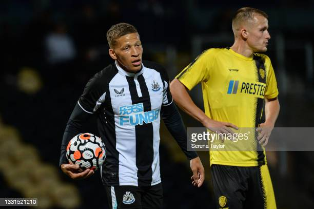 Dwight Gayle of Newcastle United FC holds a b all during the Pre Season Friendly between Burton Albion and Newcastle United at the Pirelli Stadium on...