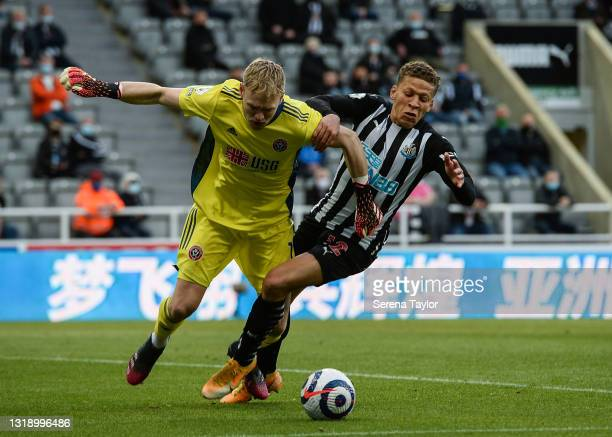 Dwight Gayle of Newcastle United FC jostles with Sheffield United Goalkeeper Aaron Ramsdale for the ball during the Premier League match between...