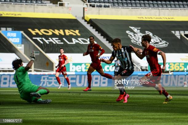 Dwight Gayle of Newcastle United FC scores the opening goal during the Premier League match between Newcastle United and Liverpool FC at St. James...
