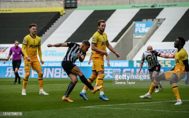 Dwight Gayle of Newcastle United FC strikes the ball during the Premier League match between Newcastle United and Tottenham Hotspur at St. James Park...