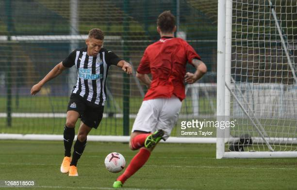 Dwight Gayle of Newcastle United FC strikes the ball during the Pre Season Friendly match between Newcastle United and Crewe Alexandra at the Queen...
