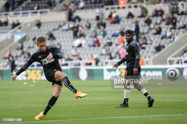 Dwight Gayle of Newcastle United FC strikes the ball in the warm up ahead of the Premier League match between Newcastle United and Sheffield United...