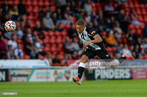 Dwight Gayle of Newcastle United FC strikes the balls during the Pre Season Friendly between Doncaster Rovers and Newcastle United at the Keepmoat...