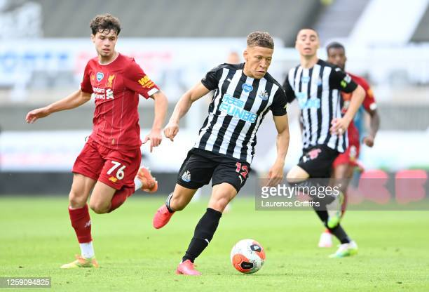 Dwight Gayle of Newcastle United gets away from Neco Williams of Liverpool during the Premier League match between Newcastle United and Liverpool FC...