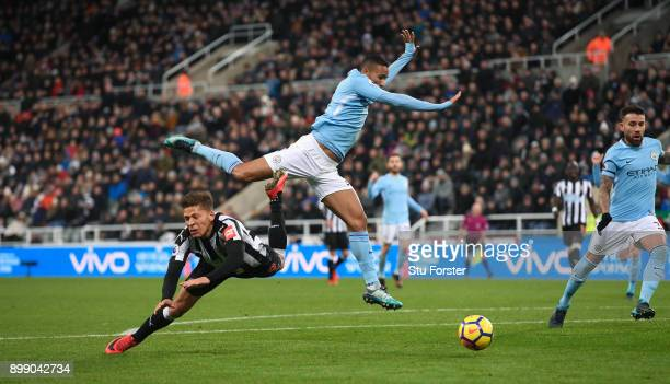 Dwight Gayle of Newcastle United goes to ground after a challenge with Danilo of Manchester City but is later booked for diving during the Premier...