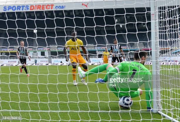 Dwight Gayle of Newcastle United has his shot saved by Hugo Lloris of Tottenham Hotspur during the Premier League match between Newcastle United and...