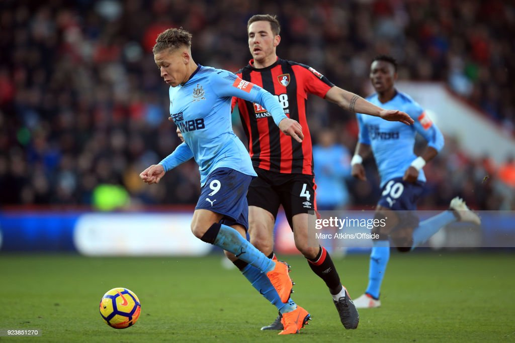 Dwight Gayle of Newcastle United in action with Dan Gosling of AFC Bournemouth during the Premier League match between AFC Bournemouth and Newcastle United at Vitality Stadium on February 24, 2018 in Bournemouth, England.