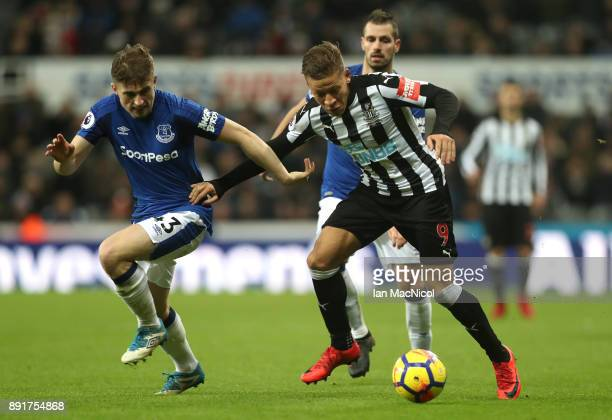 Dwight Gayle of Newcastle United is challenged by Jonjoe Kenny of Everton during the Premier League match between Newcastle United and Everton at St...
