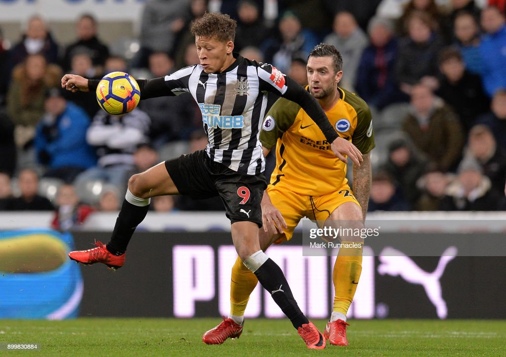 Dwight Gayle of Newcastle United is tackled by Shane Duffy of Brighton during the Premier League match between Newcastle United and Brighton and Hove Albion at St. James Park on December 30, 2017 in Newcastle upon Tyne, England.