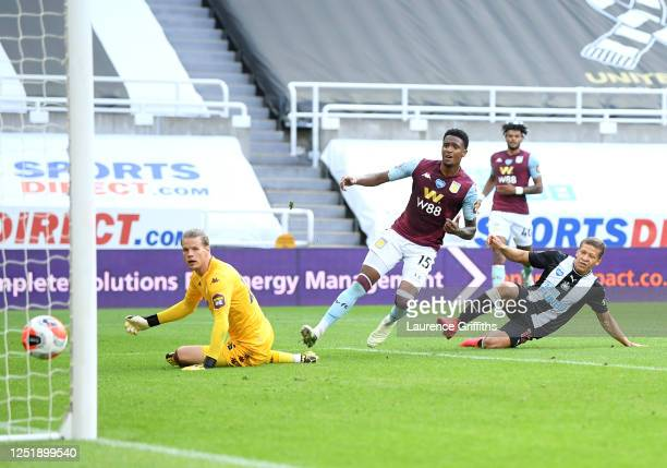 Dwight Gayle of Newcastle United scores his team's first goal during the Premier League match between Newcastle United and Aston Villa at St. James...