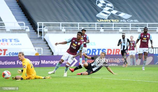 Dwight Gayle of Newcastle United scores past Orjan Nyland of Aston Villa during the Premier League match between Newcastle United and Aston Villa at...