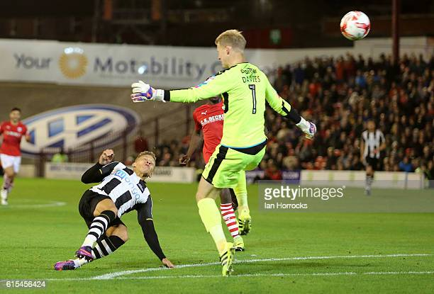 Dwight Gayle of Newcastle United scores the second goal during the English Championship match between Barnsley FC and Newcastle United FC at Oakwell...