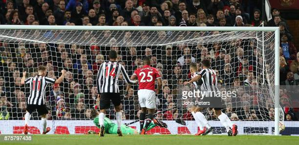 Dwight Gayle of Newcastle United scores their first goal during the Premier League match between Manchester United and Newcastle United at Old...
