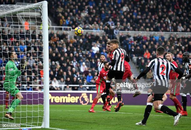 Dwight Gayle of Newcastle United wins a header and scores but it is dissallowed for offside during the Premier League match between Newcastle United...