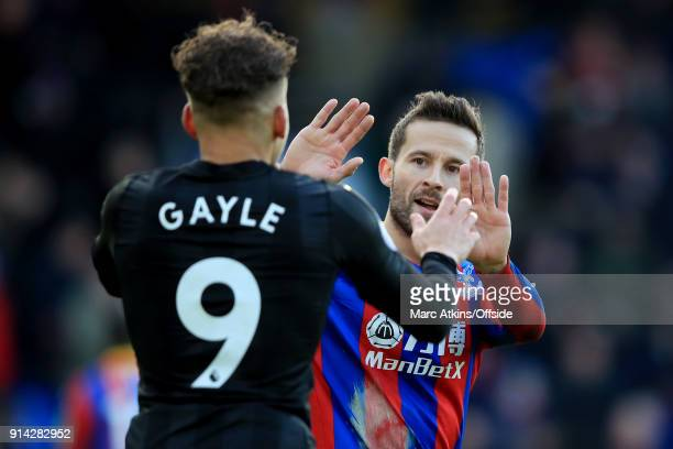 Dwight Gayle of Newcastle United with Yohan Cabaye of Crystal Palace during the Premier League match between Crystal Palace and Newcastle United at...