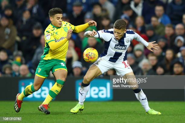 Dwight Gayle of West Bromwich Albion battles with Max Aarons of Norwich City during the Sky Bet Championship match between West Bromwich Albion and...