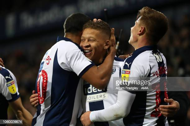 Dwight Gayle of West Bromwich Albion celebrates after scoring a goal to make it 40 with Matt Phillips of West Bromwich Albion and Harvey Barnes of...