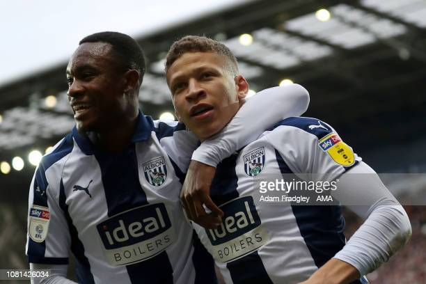 Dwight Gayle of West Bromwich Albion celebrates after scoring a goal to make it 10 with Rekeem Harper of West Bromwich Albion during the match...
