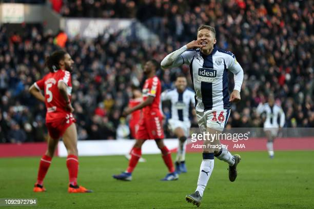 Dwight Gayle of West Bromwich Albion celebrates after scoring a goal to make it 2-1 during the Sky Bet Championship match between West Bromwich...