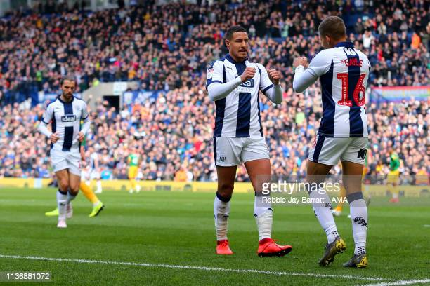 Dwight Gayle of West Bromwich Albion celebrates after scoring a goal to make it 20 during the Sky Bet Championship match between West Bromwich Albion...