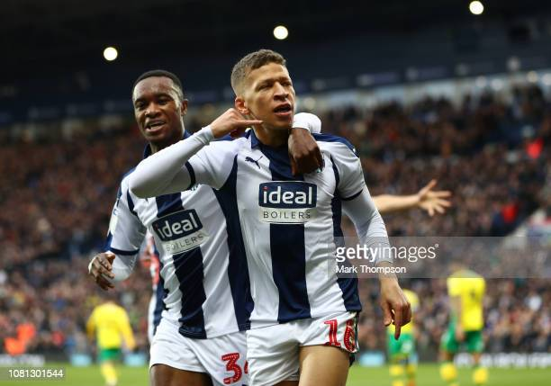 Dwight Gayle of West Bromwich Albion celebrates after scoring his team's first goal Rekeem Harper during the Sky Bet Championship match between West...