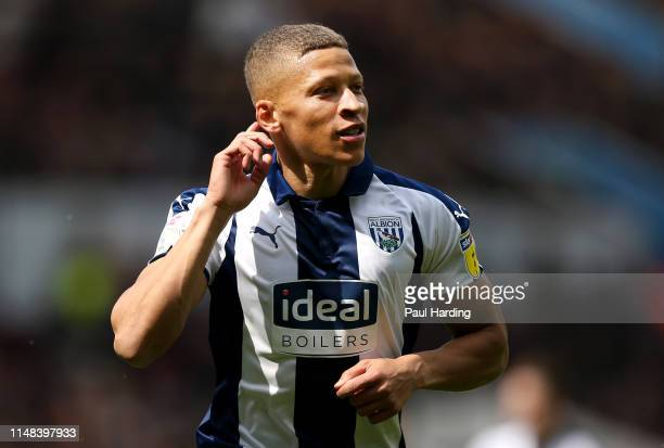 Dwight Gayle of West Bromwich Albion celebrates after scoring his team's first goal during the Sky Bet Championship Play-off semi final first leg...