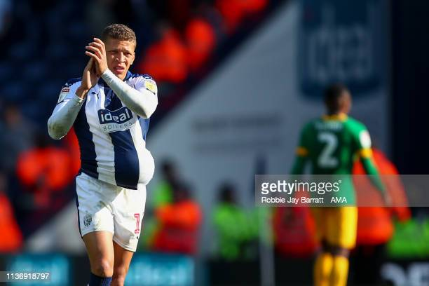 Dwight Gayle of West Bromwich Albion celebrates with the match ball at full time after his hat trick during the Sky Bet Championship match between...