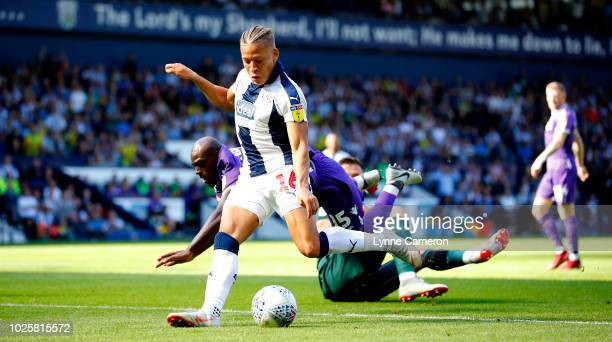 Dwight Gayle of West Bromwich Albion goes past Jack Butland of Stoke City to score during the Sky Bet Championship match between West Bromwich Albion...