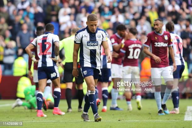 Dwight Gayle of West Bromwich Albion reacts as he receives a red card following a challenge on goalkeeper Jed Steer of Aston Villa during the Sky Bet...