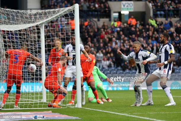 Dwight Gayle of West Bromwich Albion scores a goal to make it 10 during the Sky Bet Championship match between West Bromwich Albion and Millwall at...