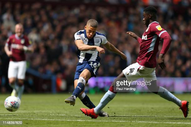 Dwight Gayle of West Bromwich Albion scores his team's first goal during the Sky Bet Championship Play-off semi final first leg match between Aston...