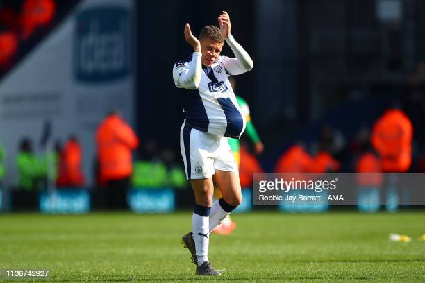 Dwight Gayle of West Bromwich Albion with the match ball after his hat trick during the Sky Bet Championship match between West Bromwich Albion and...